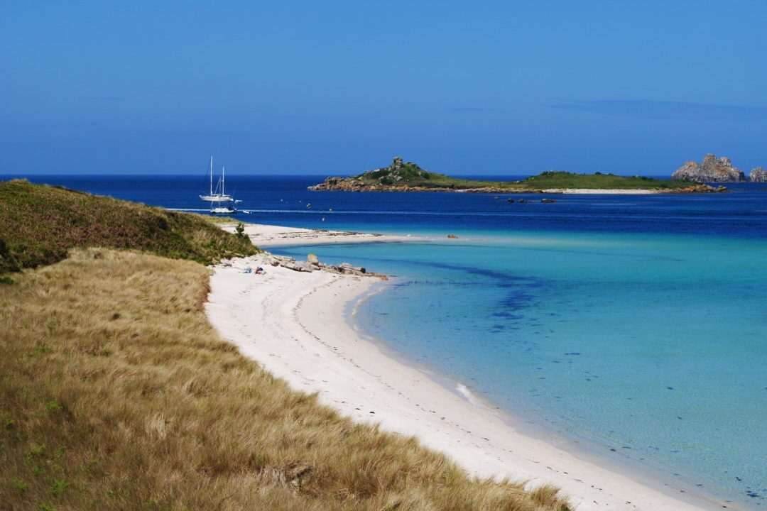 Tresco Island and Beyond with a sailing boat in the distance