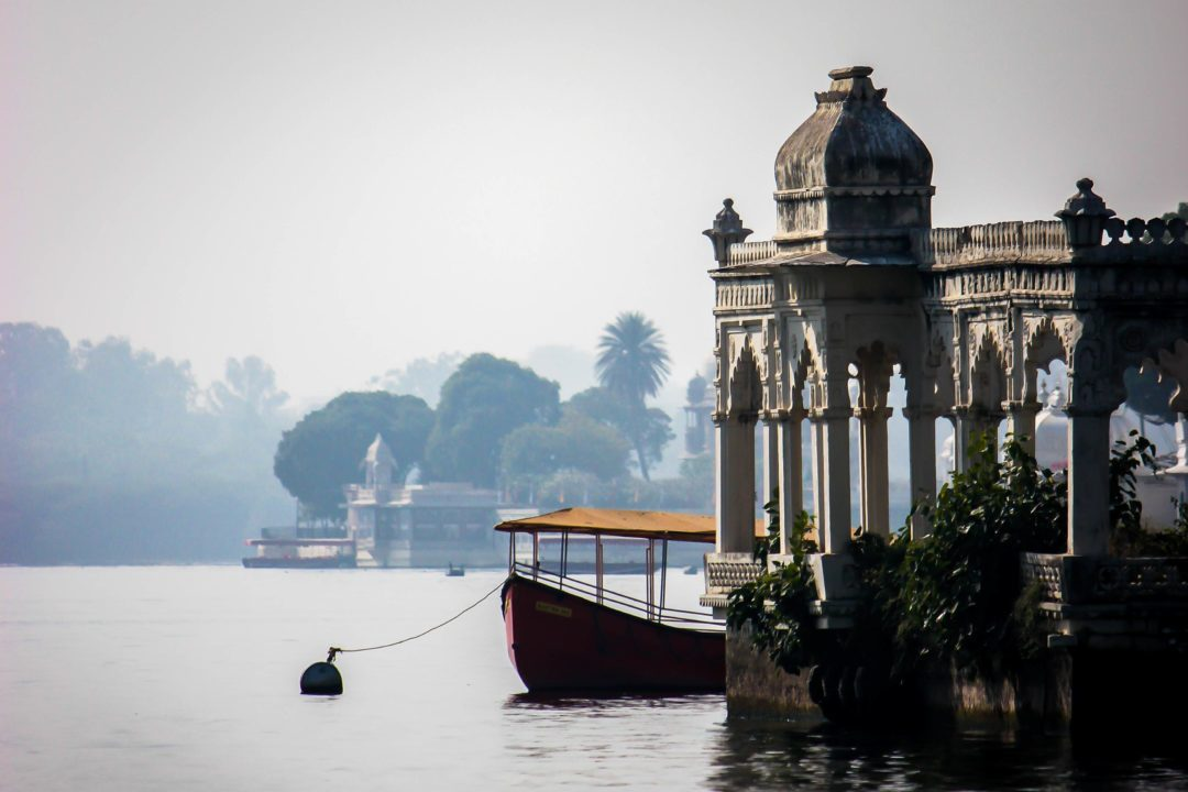 lake pichola in Udaipur with a palatial boathouse rising out of the water