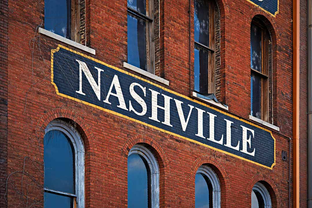 The word Nashville painted on a side of red brick building in Nashville