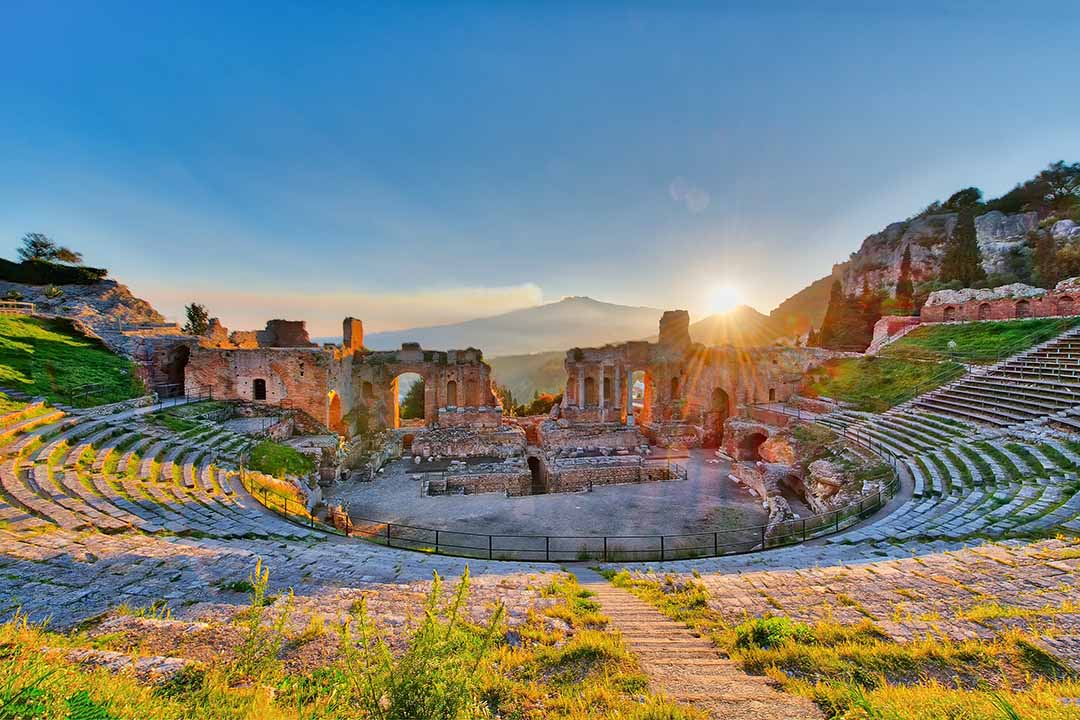 Ancient theatre of Taormina Siciliy Italy with Etna in the background at sunset