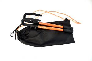 Photo description: The cane is fully collapsed with it's orange TE label on show. The cane lies on top of a black drawstring bag, with orange strings