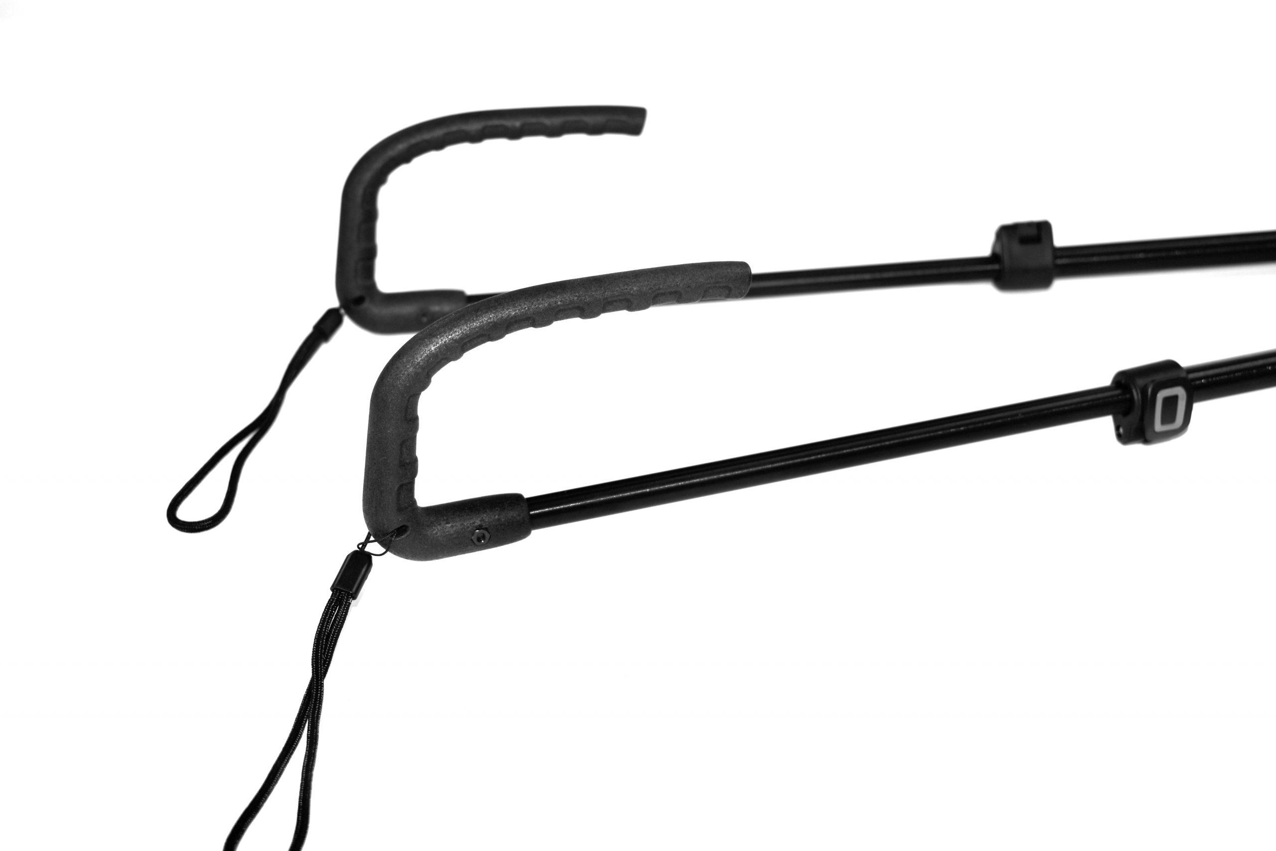 Photo description: A close up of the handles of the cane